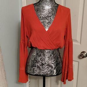 Sun and Shadow orange bell sleeve crop top